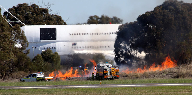 Bushfire started accidentally by pyrotechnics at RAAF Pearce Air Show - Sat 19 May 2012.
