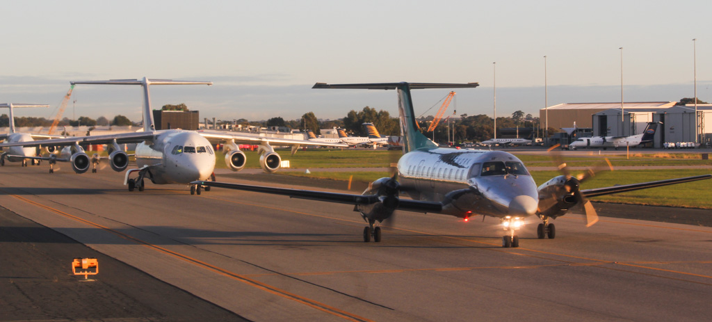 A queue of FIFO aircraft waiting to depart Perth Airport on 7 July 2011. Photo © David Eyre