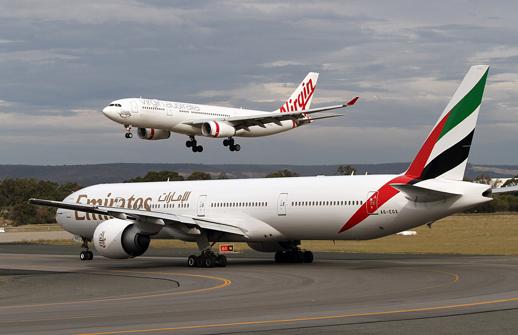"A6-EGX Boeing 777-31H ER (cn 35602/1037) of Emirates and VH-XFB Airbus A330-243 (cn 372) of Virgin Australia, named ""Cable Beach"" at Perth Airport – Wed 1 May 2013"