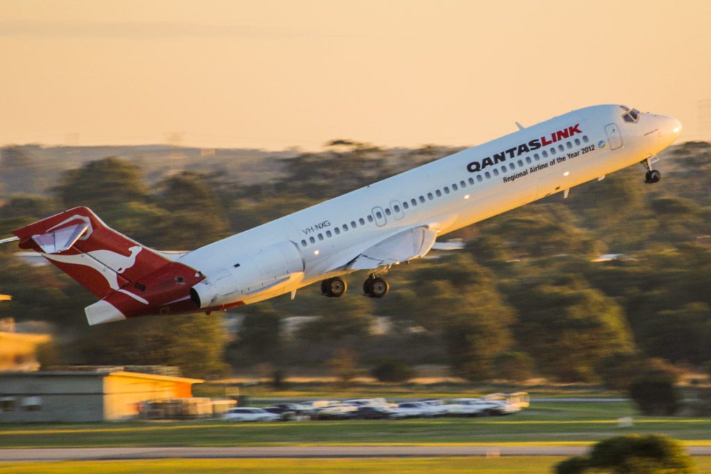 """VH-NXG Boeing 717-2K9 (cn 55057/5020) of QantasLink, with """"Regional Airline of the Year 2012"""" titles at Perth Airport – Mon 3 June 2013"""