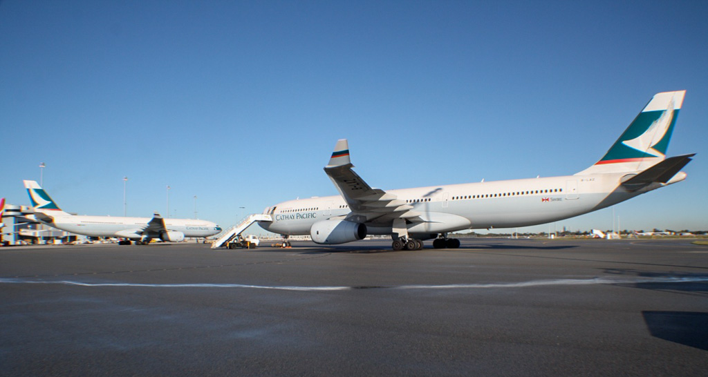 B-LAD (MSN 776)(left) and B-LAZ (MSN 1387)(right) Airbus A330-343X of Cathay Pacific at Perth Airport - Mon 10 June 2013