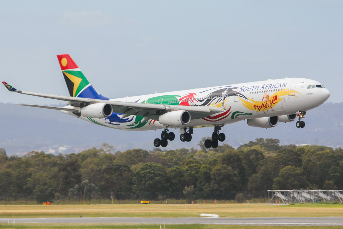 "ZS-SXD Airbus A340-313X (MSN 643) South African Airways, in special Olympics colours, named ""Siyanqoba"" at Perth Airport - Fri 27 September 2013."