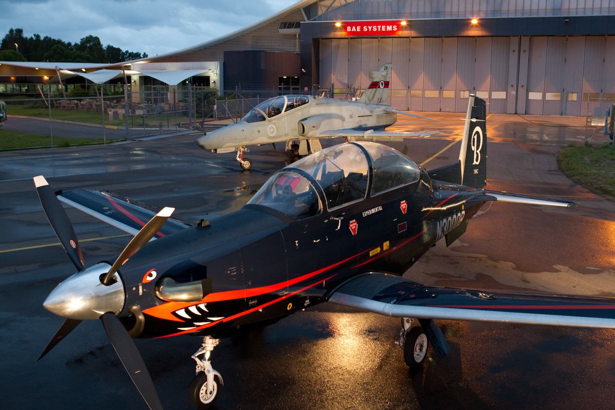 N3000B Beech T-6C Texan II (MSN PH-1) of Beechcraft Corporation with A27-28 BAE Systems Hawk 127 of 76 Sqn RAAF at RAAF Williamtown, NSW.