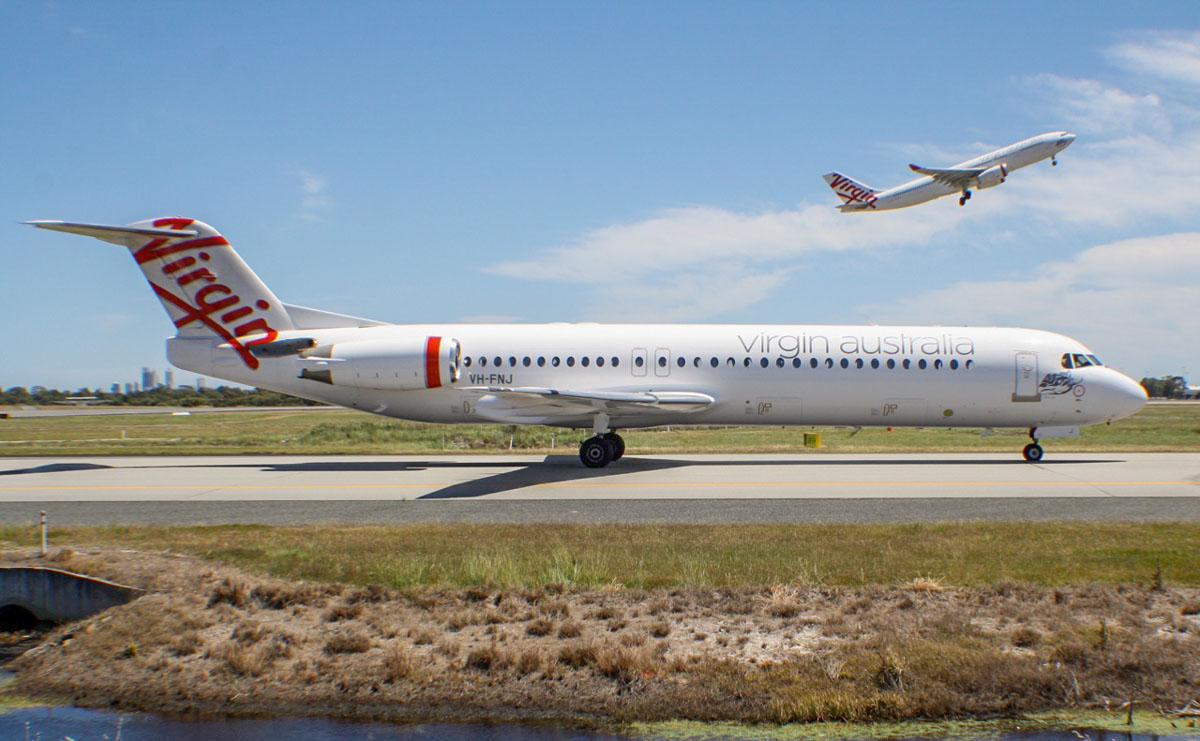 "VH-FNJ Fokker 100 (MSN 11489) of Virgin Australia Regional Airlines, named ""Talbot Bay"" & VH-XFG Airbus A330-243 (MSN 1407) of Virgin Australia, named ""Terrigal Beach"" at Perth Airport – Thu 24 October 2013."