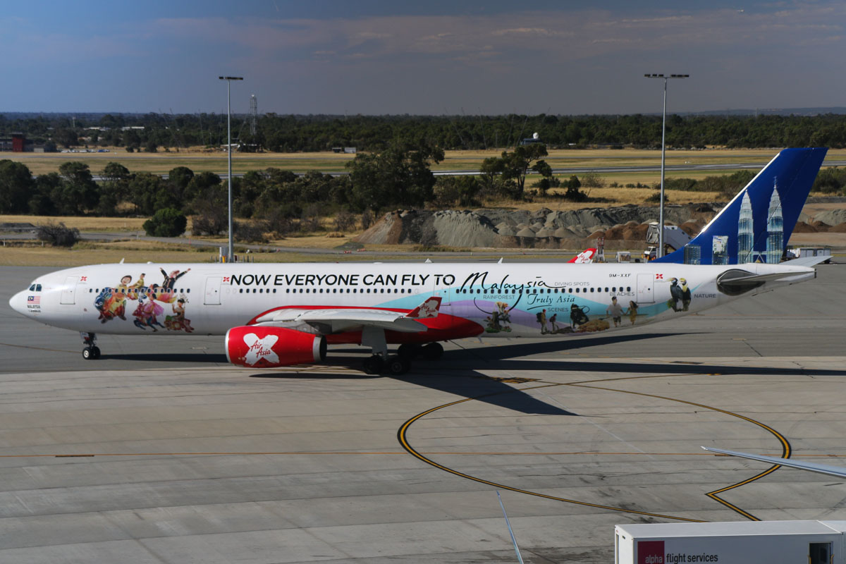 "9M-XXF Airbus A330-343X (MSN 1126) of AirAsia X, named ""Northern Xposure"", with ""Now Everyone Can Fly to Malaysia"" special livery, at Perth Airport - Thu 12 December 2013."