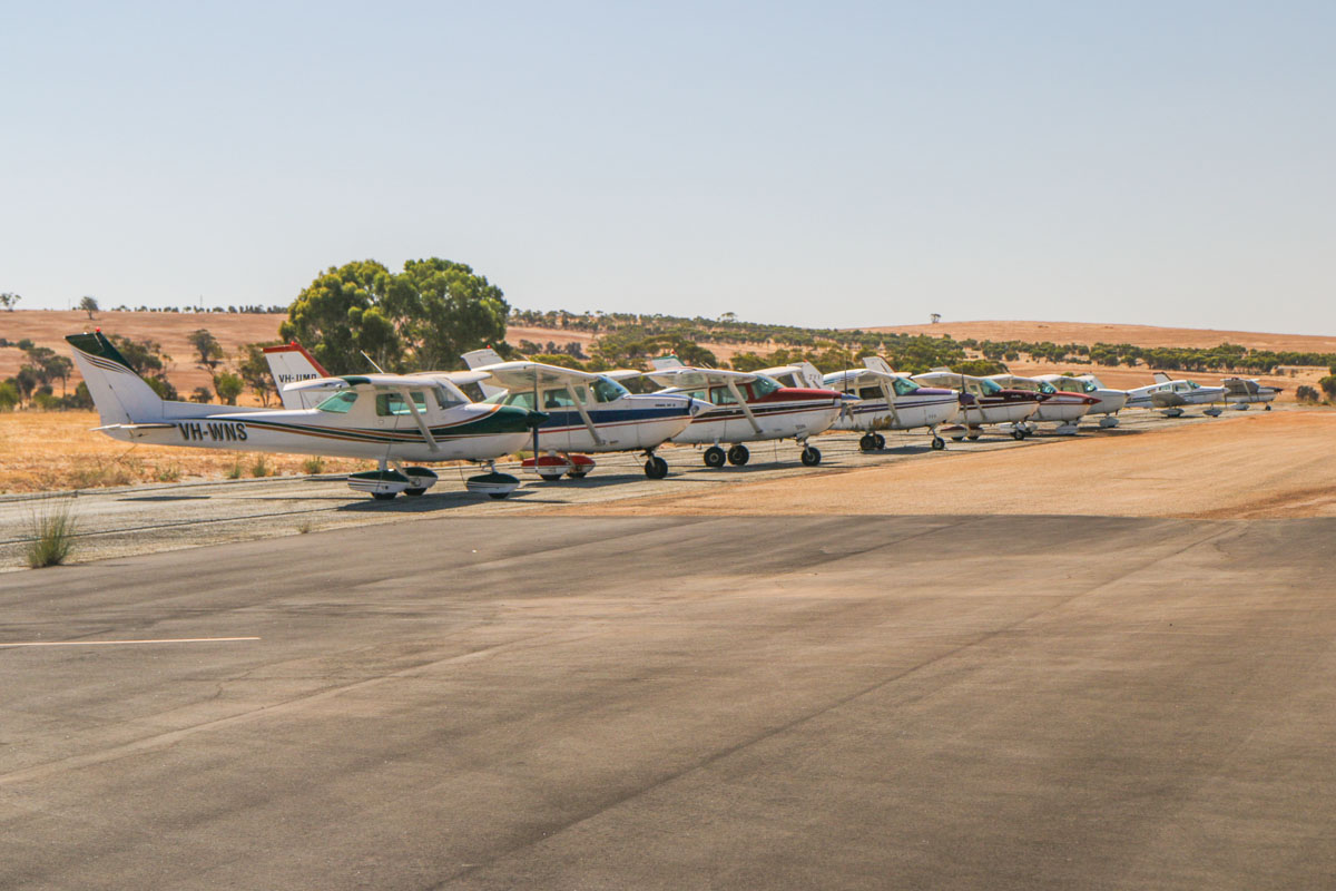 Aircraft parked at Northam Airport (YNTM) - Fri 3 January 2014: VH-WNS Cessna 150M (MSN 15078543) owned by Wade Sambell, Roebourne, WA. VH-UMD Cessna R172K Hawk XP II (MSN R1722195) owned by Najara Enterprises Pty Ltd, Grass Valley, WA. VH-JVR Cessna U206G Stationair II (MSN U20604795) operated by Lindsay Joyce, Albany, WA. VH-DKR Cessna 182G Skylane (MSN 18255298) owned by Hillman Farm Skydivers Inc. VH-JXI Cessna 172M Skyhawk II (MSN 17267407) named 'Susy Marie', owned by Errol Croft, Goomalling, WA. VH-NRC Cessna 172P Skyhawk II (MSN 17275006) owned by Norwest Air Work Pty Ltd, Exmouth, WA. VH-PRY Cessna 172P Skyhawk II (MSN 17274315) operated by Norwest Air Work Pty Ltd, owned by Eric Roulston, Exmouth, WA. VH-FES Piper PA-28-161 Warrior II (MSN 28-8216015) owned by Pearce Flying Club Inc, based at RAAF Pearce, WA. VH-UFH Cessna 172N Skyhawk II (MSN 17270650) owned by Clitech Pty Ltd, Darlington, WA. Photo © David Eyre