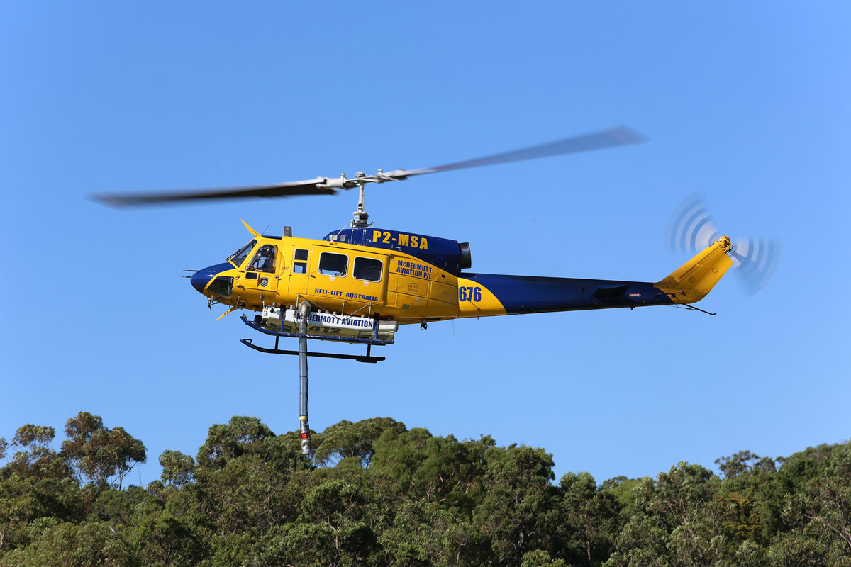 P2-MSA / HELITAC676 Bell 214B-1 Big Lifter (MSN 28065) of McDermott Aviation, on contract to the WA Department of Fire and Emergency Services, at Glen Forrest Oval, Glen Forrest, east of Perth - Sun 12 January 2014. Photo © Matt Hayes