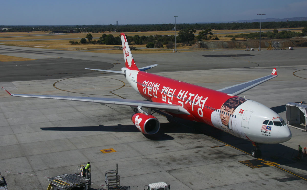 "9M-XXO Airbus A330-343X (MSN 692) of AirAsia X (leased from ILFC), with ""THANK YOU CAPTAIN PARK"" special livery, at Perth Airport - Sun 26 January 2014. Photo © Steve Jaksic"