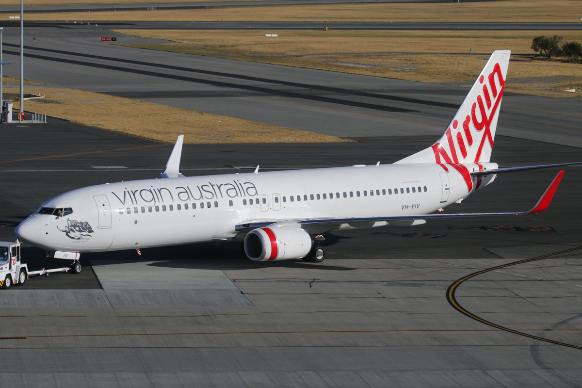 "VH-YIV Boeing 737-8FE (MSN 40698/4571) of Virgin Australia, named ""Cylinder Beach"", at Perth Airport – Tue 28 January 2014. Photo © David Eyre"