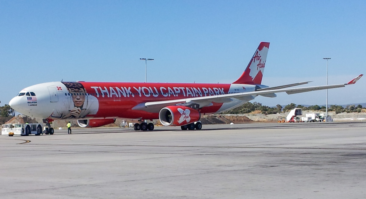 "9M-XXO Airbus A330-343X (MSN 692) of AirAsia X (leased from ILFC), with ""THANK YOU CAPTAIN PARK"" special livery, at Perth Airport – Sun 26 January 2014. Photo © Wilson"