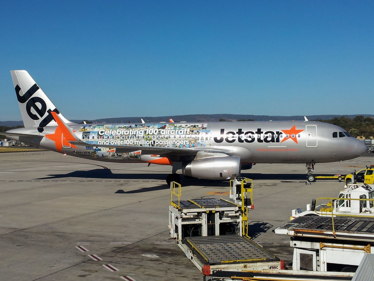 "VH-VFN Airbus A320-232 (MSN 5566) of Jetstar (leased from BOC Aviation Corp) – special ""Celebrating 100 aircraft and over 100 million passengers"" livery at Perth Airport - Mon 27 January 2014. Photo © Wilson"