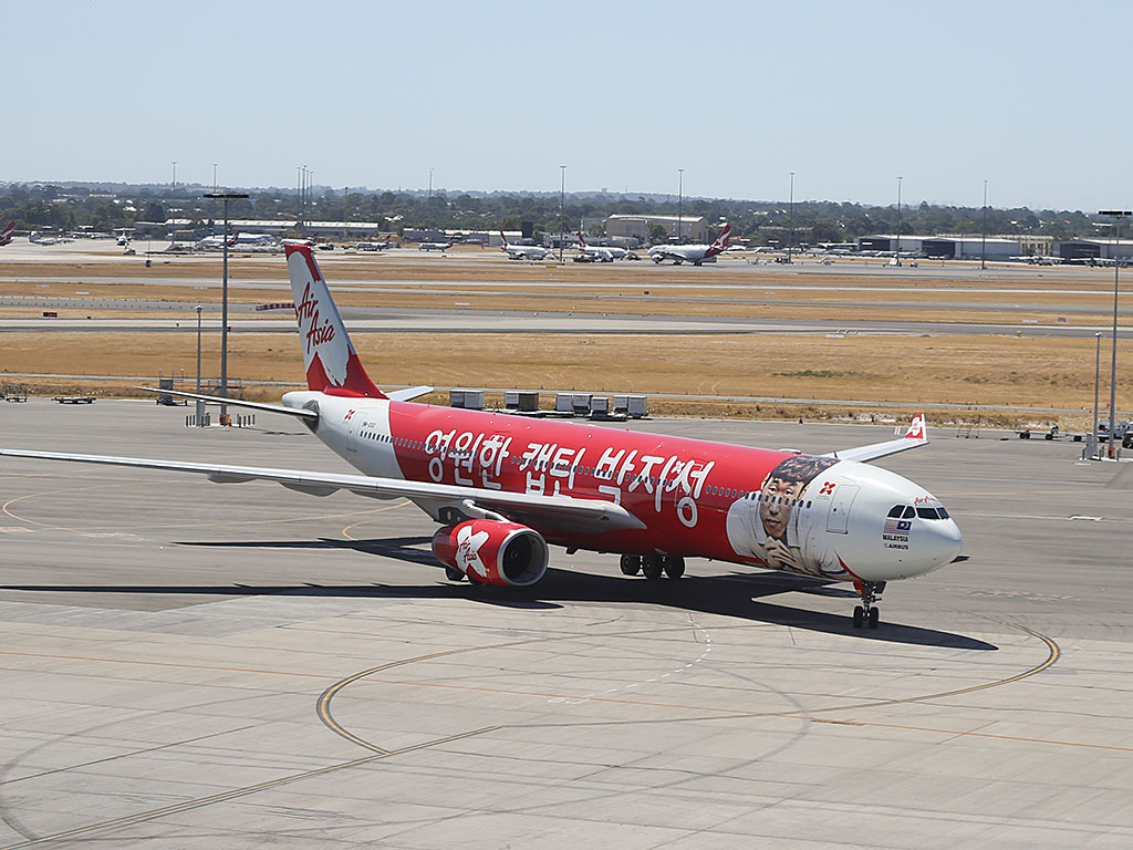 "9M-XXO Airbus A330-343X (MSN 692) of AirAsia X (leased from ILFC), with ""THANK YOU CAPTAIN PARK"" special livery, at Perth Airport – Sun 2 February 2014. Photo © Keith Anderson"
