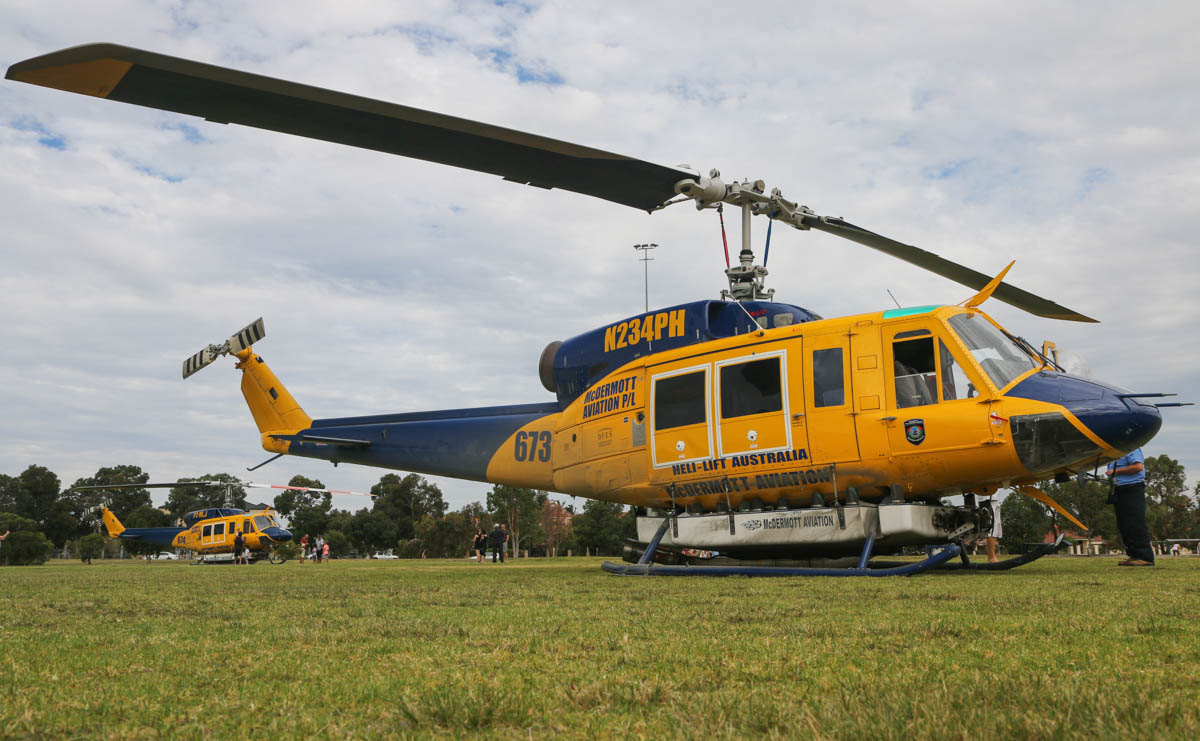 N234PH / HELITAK673 (MSN 28050) & P2-MLJ / HELITAC 674 (MSN 28066) Bell 214B1 BigLifter of McDermott Aviation, operated for the WA Department of Fire and Emergency Services, at Warradale Park, Landsdale – Sun 16 February 2014. Photo © David Eyre