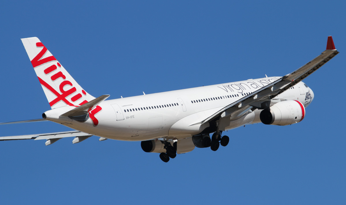 "VH-XFE Airbus A330-243 (MSN 1319) of Virgin Australia, named ""Manly Beach"", at Perth Airport – Wed 19 February 2014. Photo © David Eyre"