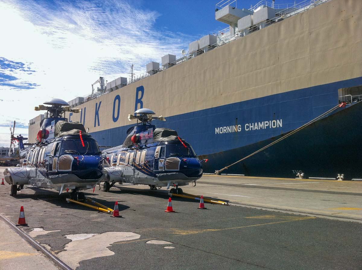 VH-NWC (MSN 2826) & VH-NWG (MSN 2879) Airbus Helicopters EC225LP of Bond Helicopters Australia Pty Ltd, next to vehicle carrier Morning Champion at North Quay, Fremantle - Thu 20 February 2014. Photo © Jim Clark