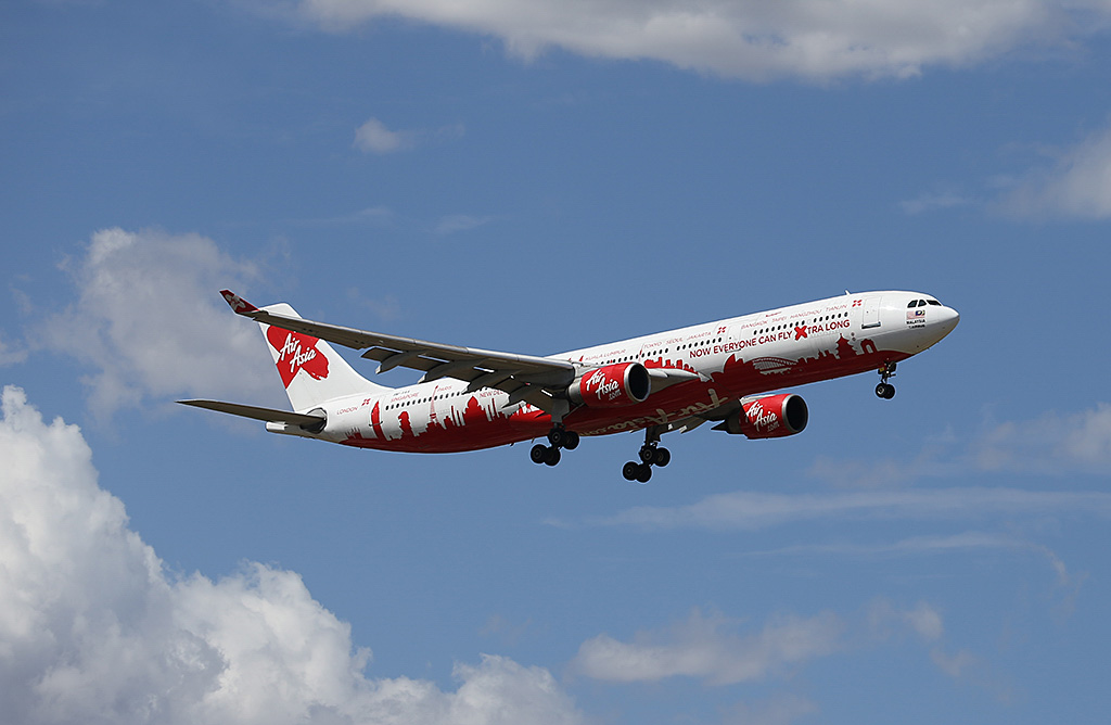 """9M-XAA Airbus A330-301 (MSN 054) of AirAsia X (leased from AWAS) in world cities special livery, named """"Semangat Sir Freddie"""", at Perth Airport - Sat 22 February 2014. Photo © Keith Anderson"""
