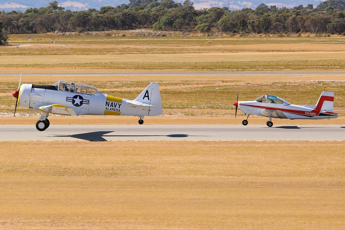 VH-WWA / A – 106 North American AT-6D Texan (MSN 78-7094) owned by Adrian Thomas, and VH-MRI Victa Airtourer 115 (MSN 158) owned by Susan Clarke at Jandakot Airport – Sat 1 March 2014. Photo © Matt Hayes