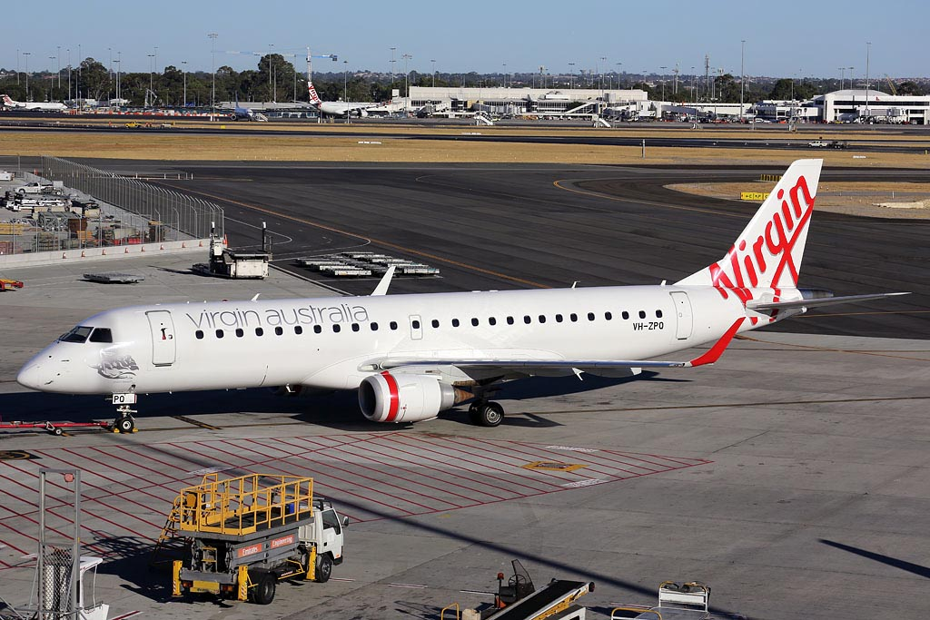 "VH-ZPQ Embraer 190AR (ERJ-190-100IGW) (MSN 1900412) of Virgin Australia, named ""Main Beach"", at Perth Airport - Sat 1 March 2014. Photo © Ian Moy"