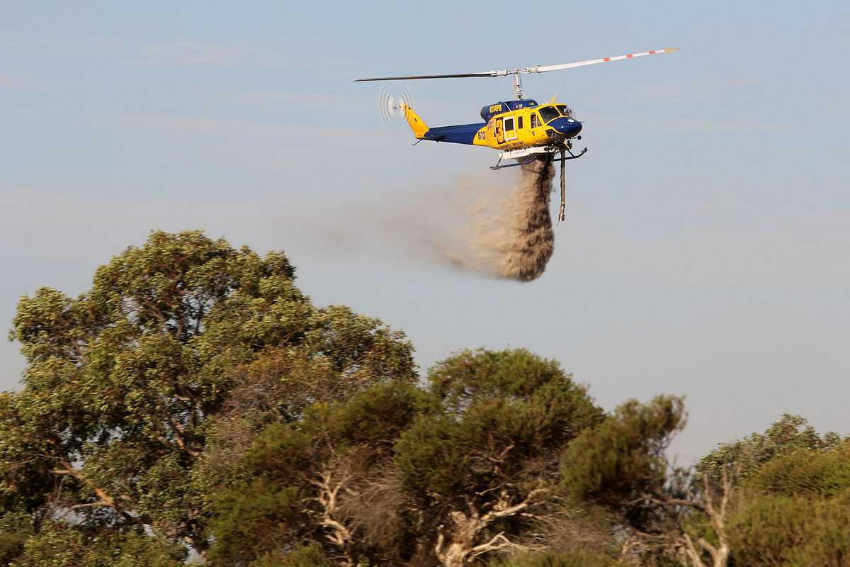 N234PH / HELITAK673 / 3 Bell 214B-1 BigLifter (MSN 28050) of McDermott Aviation, operated for the WA Government on fire fighting duties, at Bennett Springs – Mon 3 March 2014. Photo © Matt Hayes