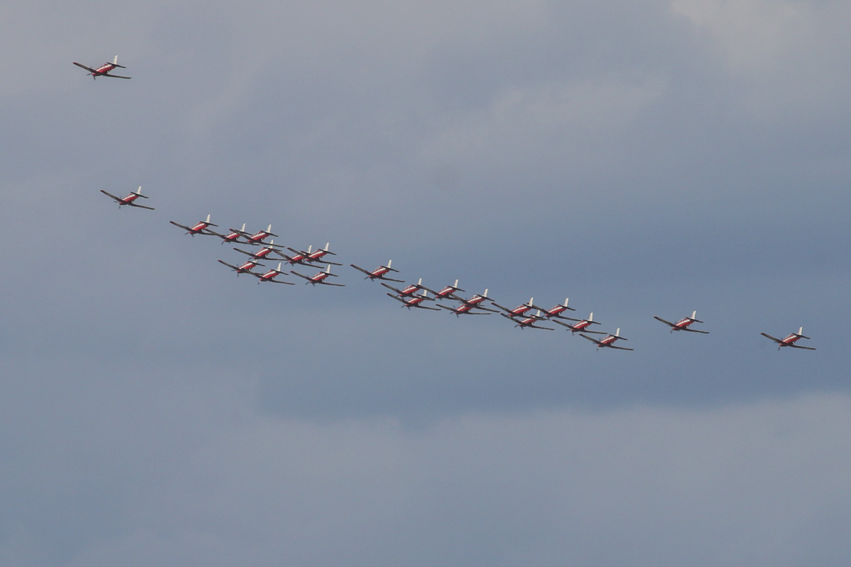 23 Pilatus PC-9/A aircraft of 2 Flying Training School (2FTS), RAAF, based at Pearce, WA, in Thunderbird formation, plus one extra as camera ship, over the northern suburbs of Perth – Wed 12 March 2014.
