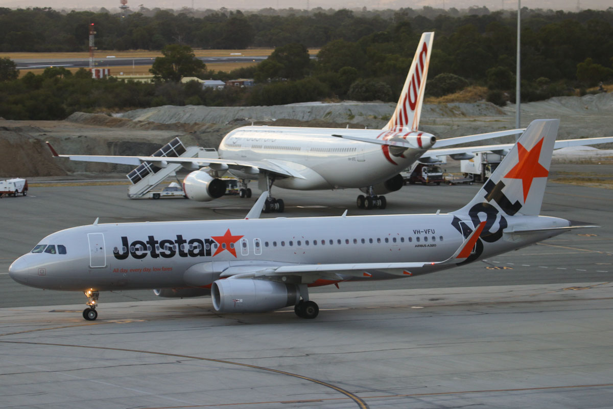 "VH-VFU Airbus A320-232 (sharklets) (MSN 5814) of Jetstar and VH-XFE Airbus A330-243 (MSN 1319) of Virgin Australia, named ""Manly Beach"", at Perth Airport – Fri 21 March 2014. Photo © David Eyre"