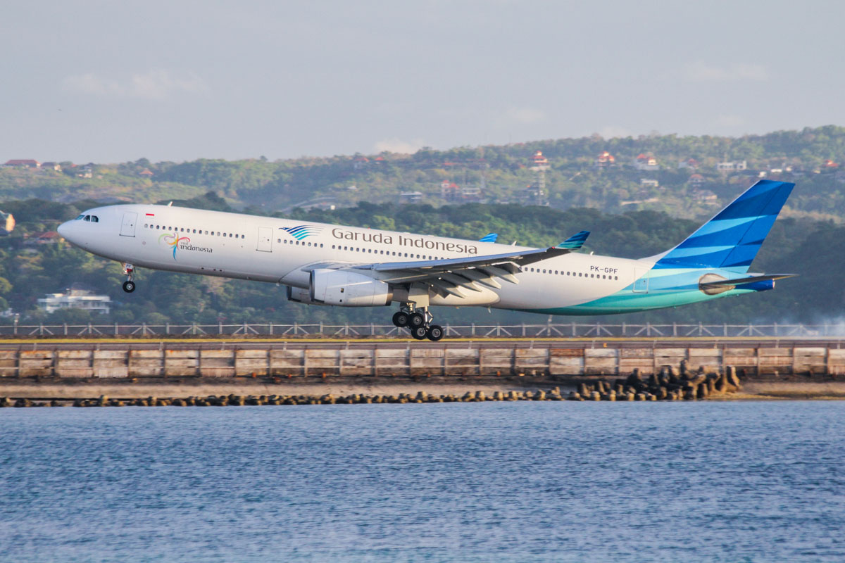 PK-GPF Airbus A330-341 (cn 153) of Garuda Indonesia landing on runway 09 at Denpasar Airport as flight GA881 from Tokyo-Narita at 17:43. Copyright © David Eyre