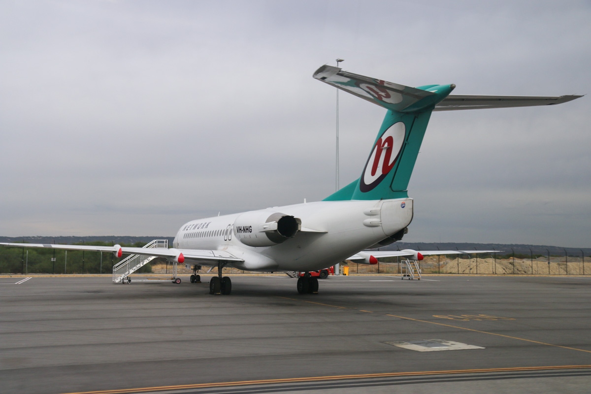 VH-NHG Fokker 100 (MSN 11514) of Network Aviation, at Perth Airport – Fri 4 April 2014. Photo © David Eyre