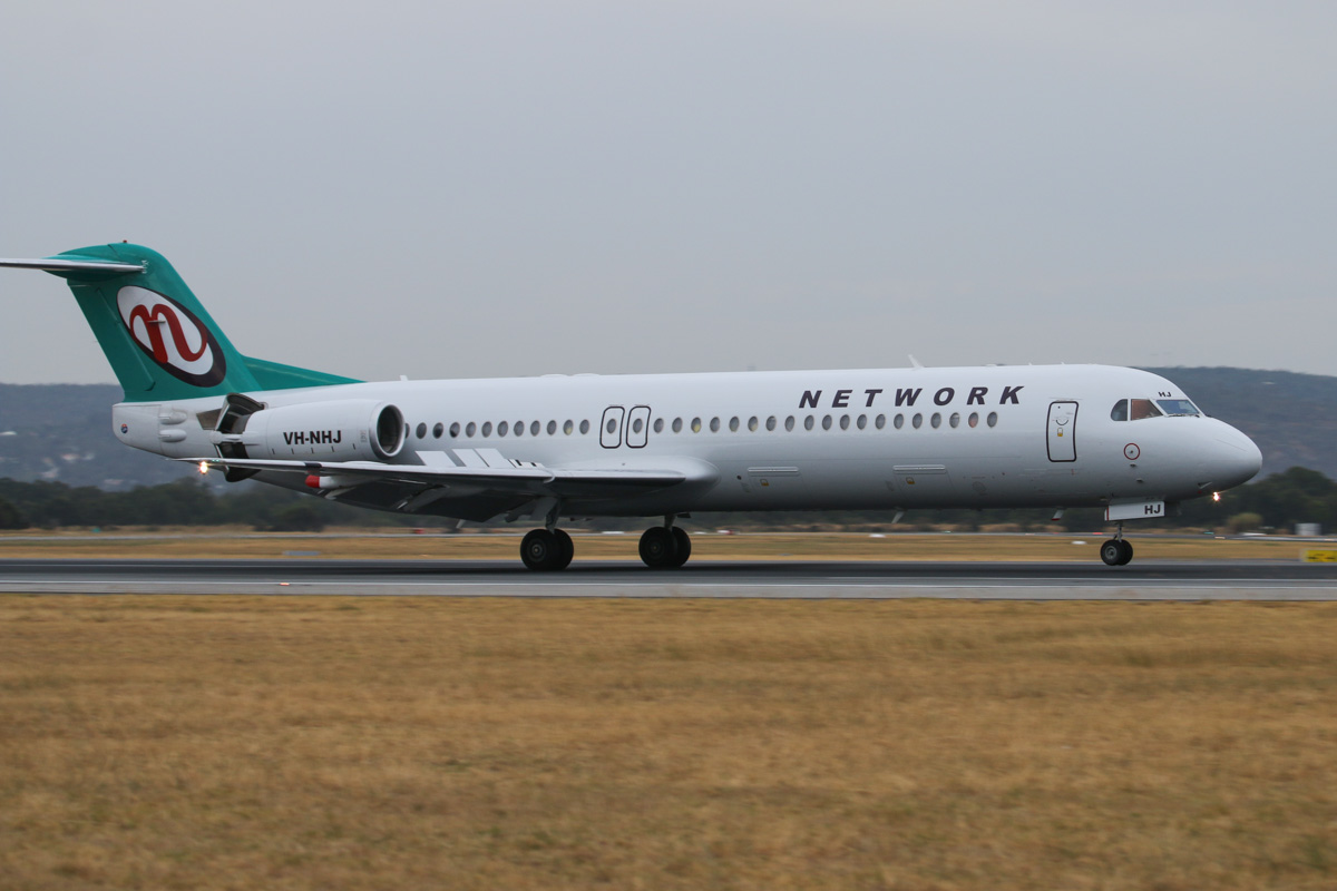 VH-NHJ Fokker 100 (MSN 11464) of Network Aviation, at Perth Airport– Fri 4 April 2014. Photo © David Eyre
