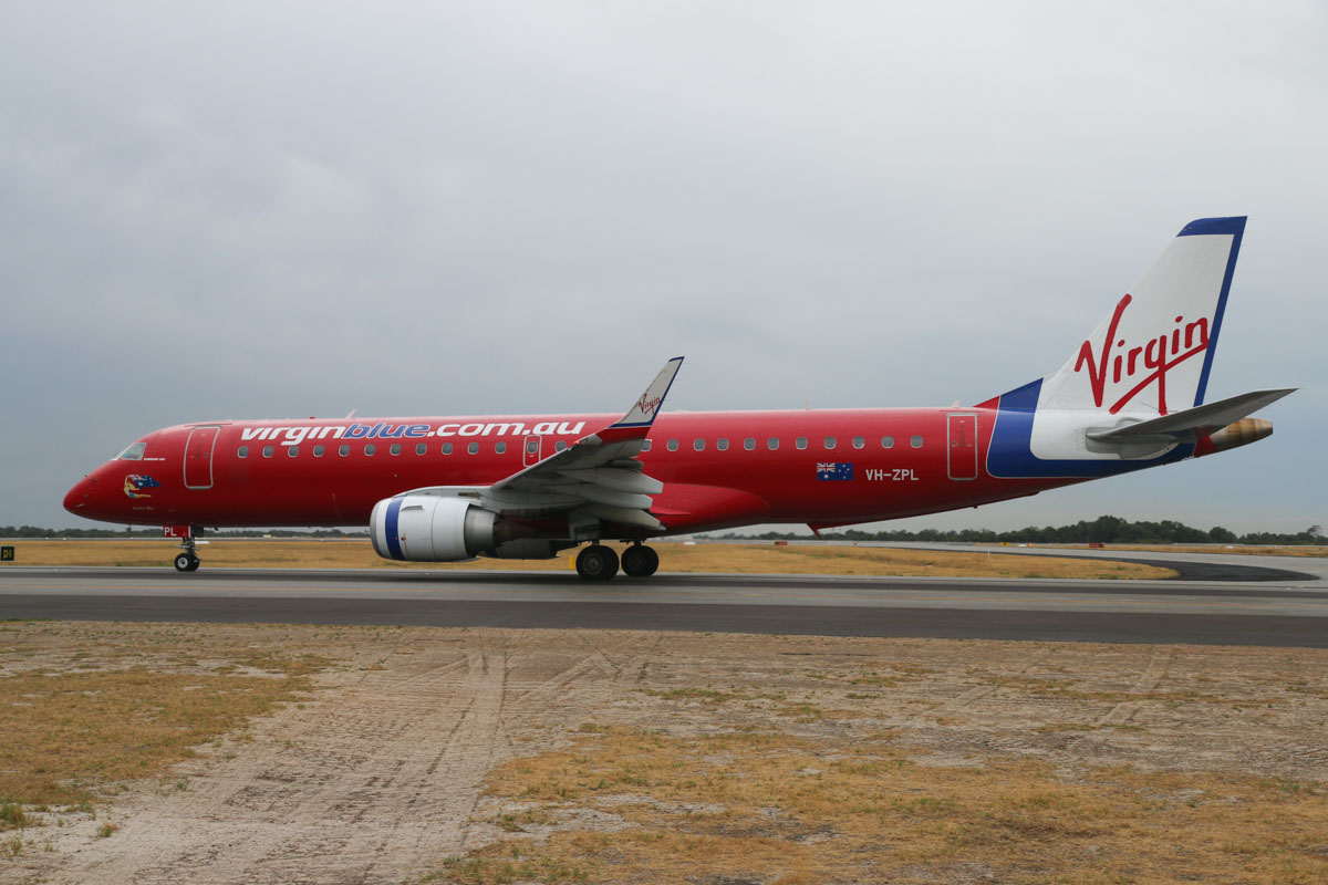 VH-ZPL Embraer 190AR (ERJ-190-100IGW) (MSN 19000220) of Virgin Australia (still in Virgin Blue livery), named 'Samba Blue', at Perth Airport– Fri 4 April 2014. Photo © David Eyre