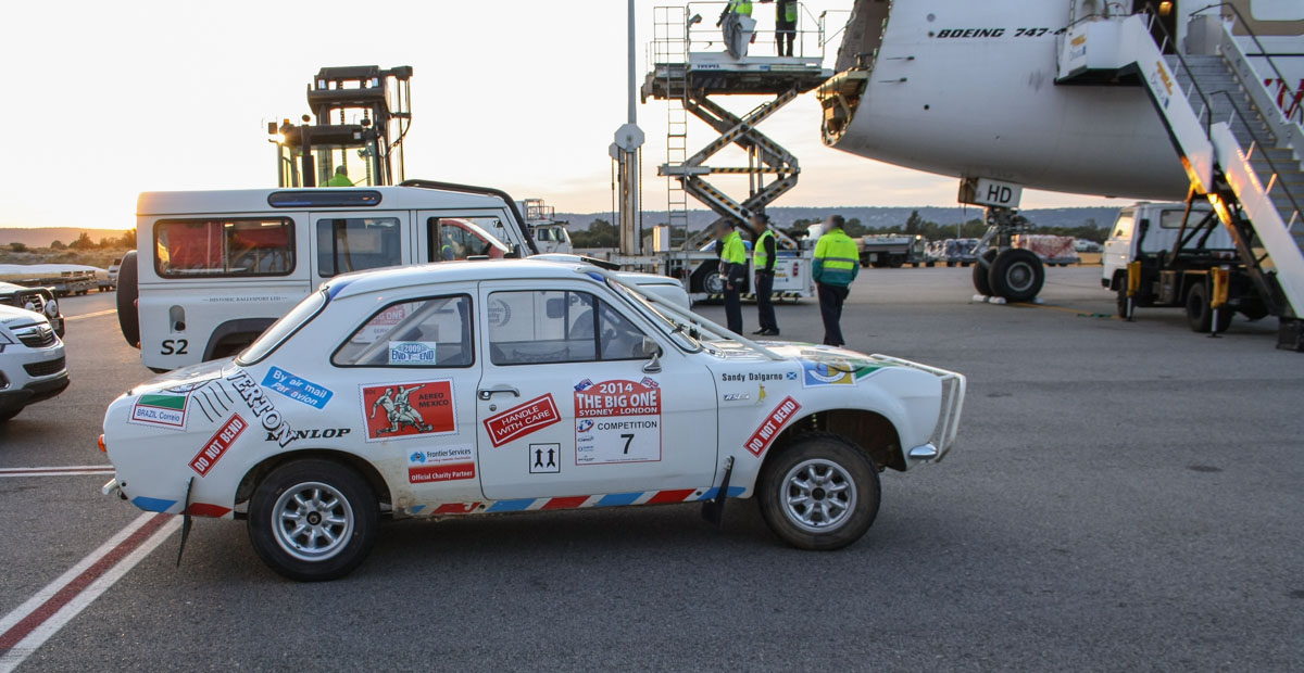 Cars for Sydney-London 2014 Rally, next to OO-THD Boeing 747-4HAF(ER) (MSN 35236 / 1399) of Emirates SkyCargo at Perth Airport – Wed 23 April 2014. Photo © Wilson