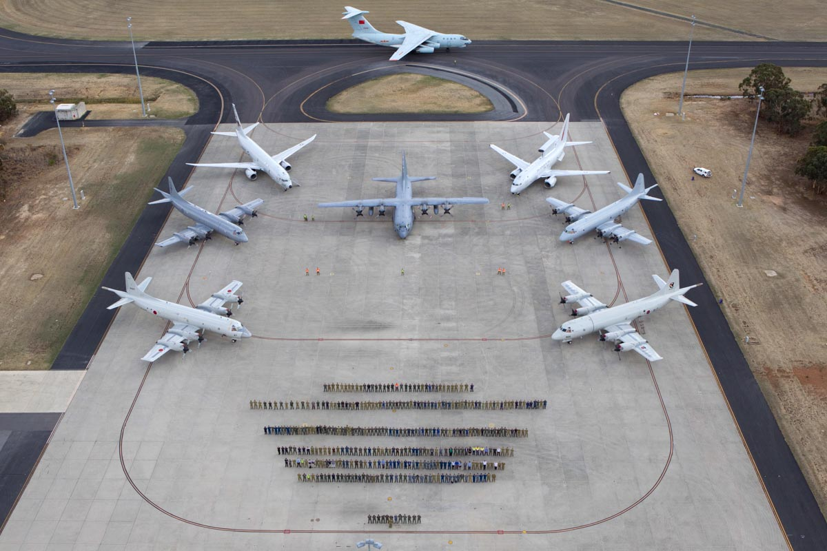 Personnel and eight of the multinational aircraft involved in the Australian air search for missing Malaysia Airlines flight MH370, at RAAF Base Pearce - Tue 29 April 2014. Photo: CPL Colin Dadd, © Commonwealth of Australia, Department of Defence - 20140429raaf8194170_0010.