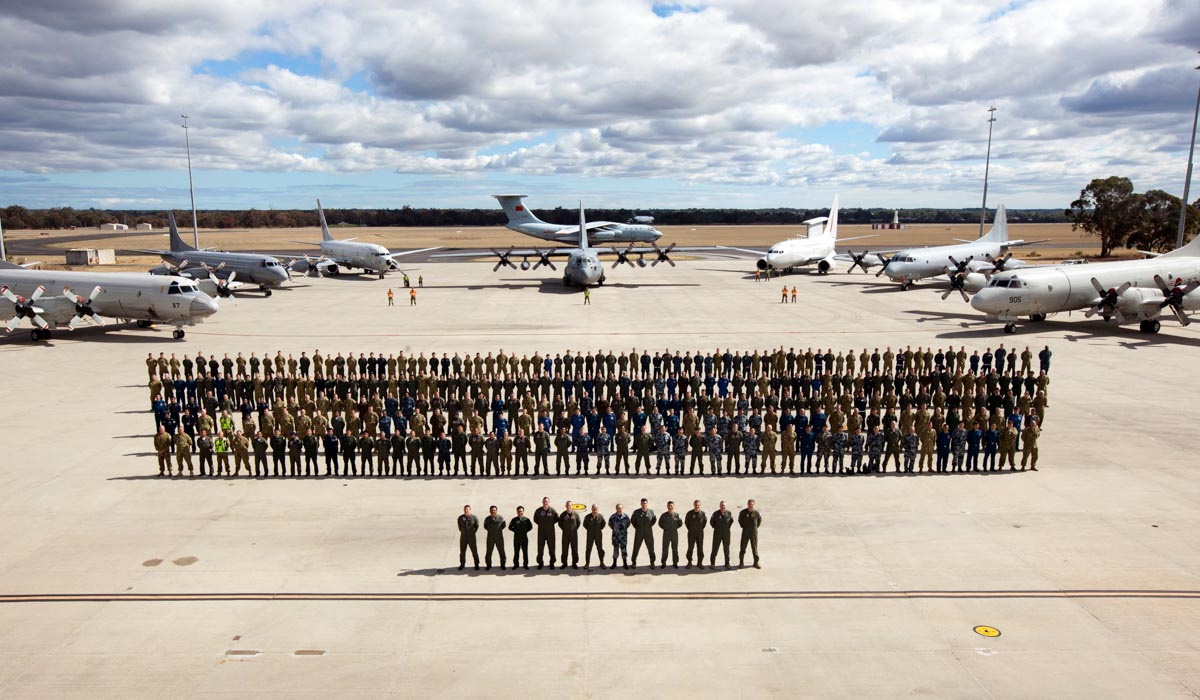 Personnel and eight of the multinational aircraft involved in the Australian air search for missing Malaysia Airlines flight MH370, at RAAF Base Pearce - Tue 29 April 2014. Photo: CPL Nicci Freeman, © Commonwealth of Australia, Department of Defence - 20140429raaf8227810_0084.