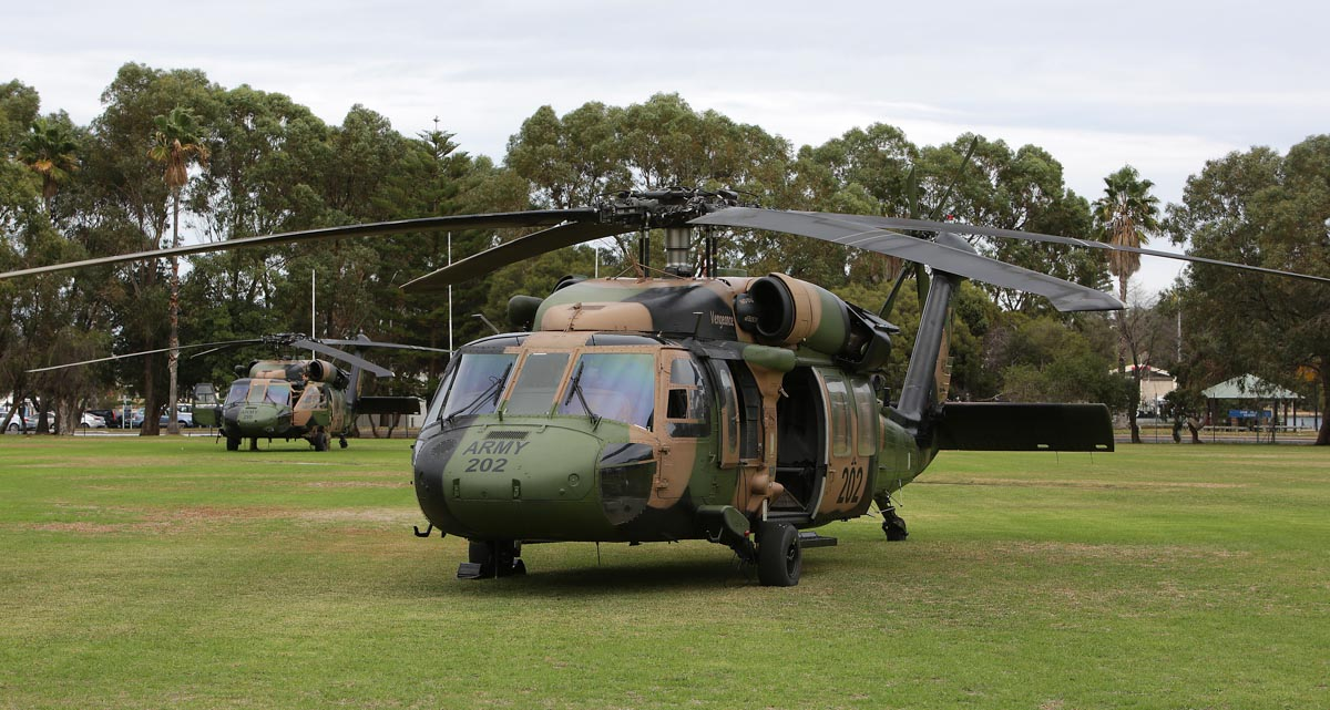 "A25-202 (MSN 70-1299) 'Vengeance' and A25-210 (MSN 70-1348) ""Dragoon"" of Australian Army, 6th Aviation Regiment, on the sports field at Leeuwin Barracks, East Fremantle, WA - Mon 5 May 2014."