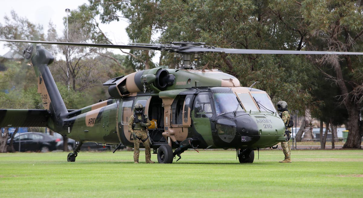 "A25-210 Sikorsky S-70A-9 Blackhawk (MSN 70-1348) ""Dragoon"" of Australian Army, 6th Aviation Regiment, on the sports field at Leeuwin Barracks, East Fremantle, WA - Mon 5 May 2014. Photo ©Commonwealth of Australia, ABIS Chris Beerens, 20140505ran8526162_023"