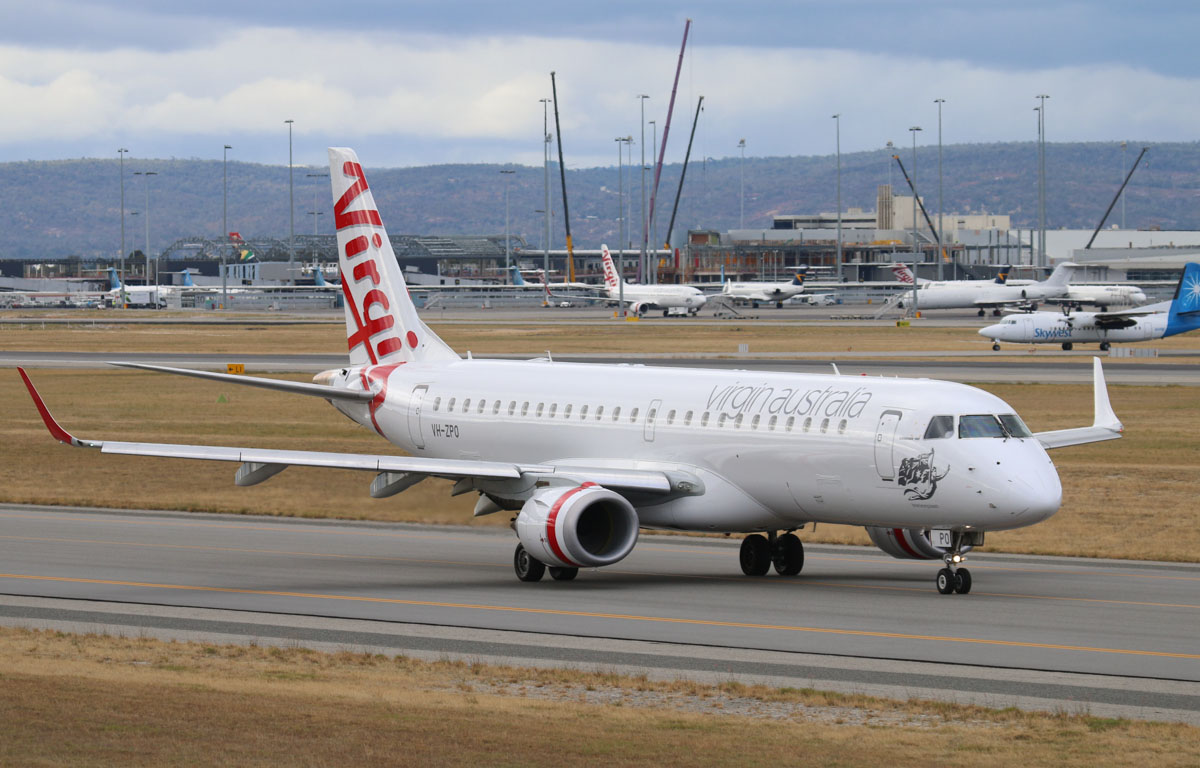 "VH-ZPO Embraer 190AR (ERJ 190-100IGW) (MSN 19000321) of Virgin Australia, named ""Boomerang Beach"", at Perth Airport – Mon 5 May 2014. Photo © Steve Jaksic"