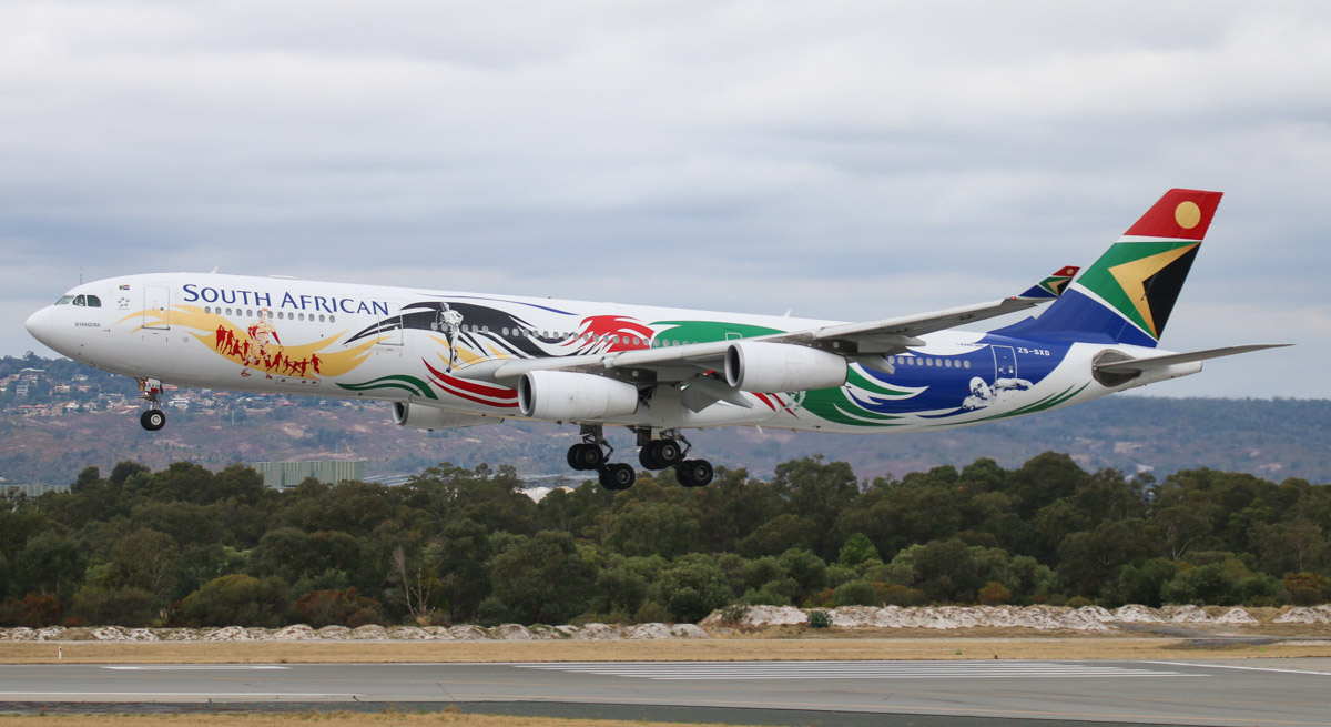"ZS-SXD Airbus A340-313X (MSN 643) South African Airways, in special Olympics colours, named ""Siyanqoba"" at Perth Airport – Tue 6 May 2014. Photo © Steve Jaksic"