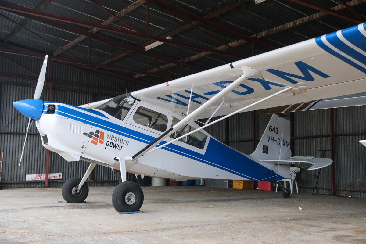 VH-DXM / SPOTTER 643 (MSN 504-2008) American Champion 8GCBC Scout of the Department of Parks and Wildlife, with Western Power sponsor logos, at Bunbury Airport – Fri 9 May 2014. Photo © David Eyre