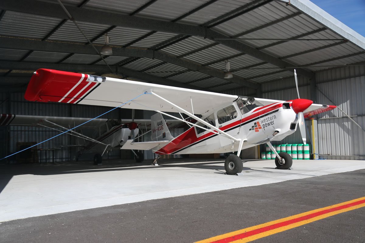VH-KUE / SPOTTER 648 American Champion 8GCBC Scout (MSN 554-2013) of the Department of Parks and Wildlife, with Western Power sponsorship logo, at Jandakot Airport – Fri 30 May 2014. Photo © David Eyre