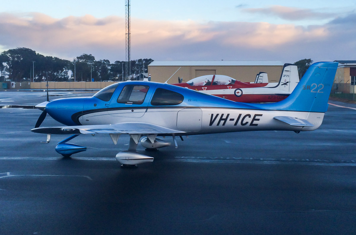 VH-ICE Cirrus SR22 GTS (MSN 4063) owned by Andrew Dean, at Geraldton Airport - 15 July 2014. This Jandakot-based Cirrus is brand new (built in 2014), and seen here parked next to a trio of Pilatus PC-9/A aircraft of 2 Flying Training School, RAAF, based at RAAF Pearce, north of Perth - the PC-9s were on a navigation training flight. Photo © Corrie Watts