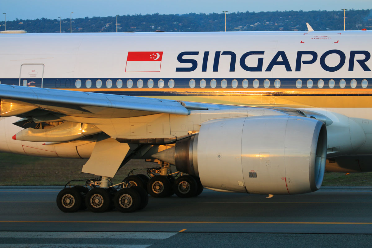 9V-SRN Boeing 777-212ER (MSN 32318/441) of Singapore Airlines, at Perth Airport - Thu 17 July 2014. Close-up of one of the Rolls-Royce Trent 892 turbofan engines and the undercarriage. Flight SQ214 to Singapore, taxying to runway 03 at 17:15 Photo © David Eyre