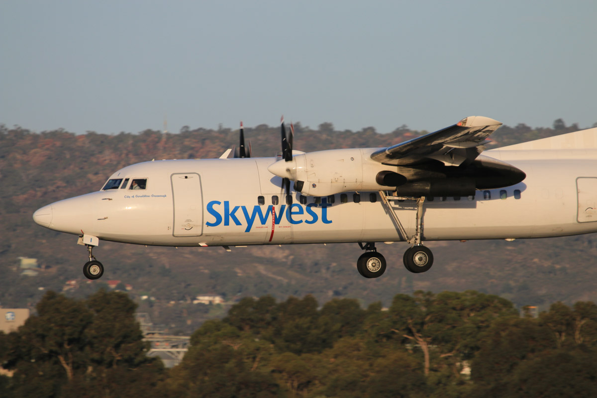 VH-FNI Fokker 50 (MSN 20114) of Virgin Australia Regional Airlines (still in Skywest livery), named 'City of Geraldton-Greenough', at Perth Airport - Thu 17 July 2014. Landing on runway 03 at 16:50, arriving from Windarling. Photo © David Eyre