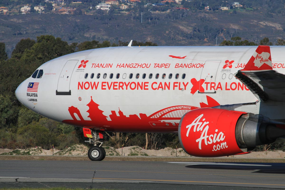 9M-XAA Airbus A330-301 (MSN 054) of AirAsia X, in World Cities special livery, named 'Semangat Sir Freddie', at Perth Airport – Fri 18 July 2014. Named in honour of Sir Freddie Laker, one of the pioneers of low cost air travel. Lining up on runway 03 for takeoff at 16:03 as flight D7 233 to Kuala Lumpur Photo © David Eyre