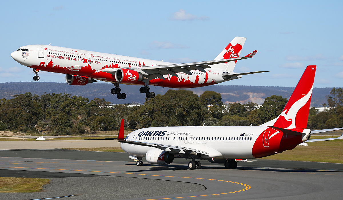 "9M-XAA Airbus A330-301 (MSN 054) of AirAsia X (leased from AWAS) in world cities special livery, named ""Semangat Sir Freddie"", at Perth Airport – Fri 18 July 2014."