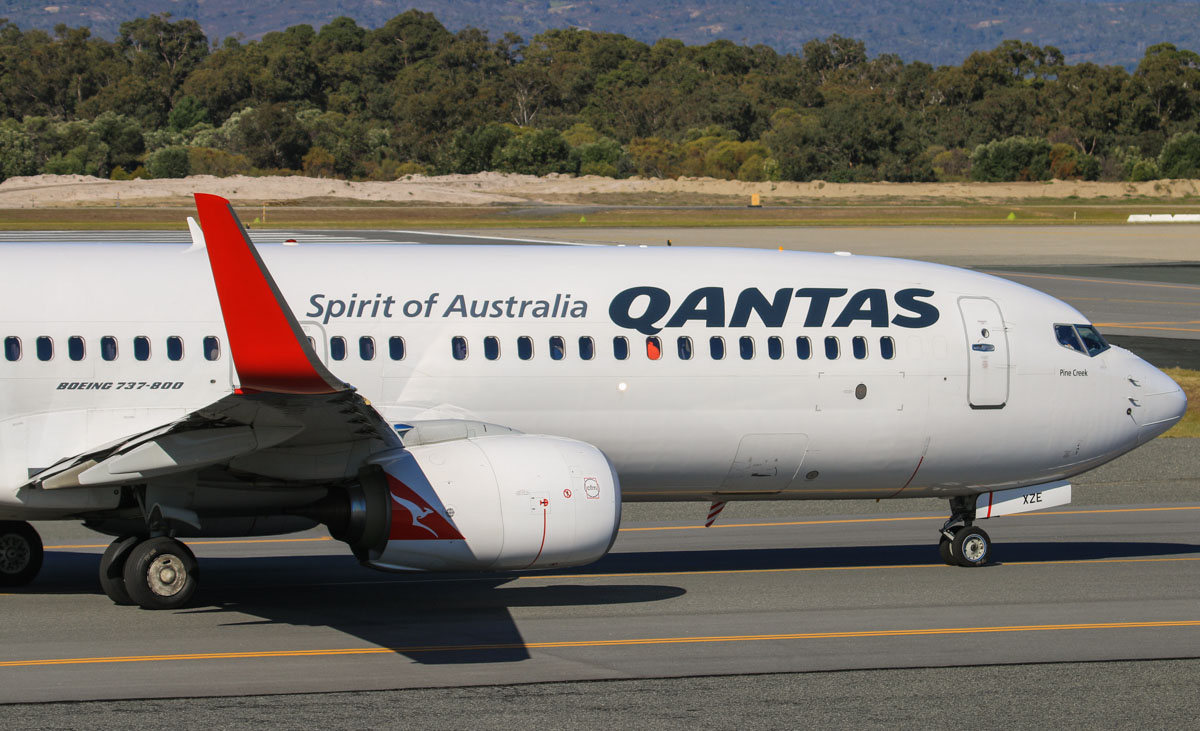 VH-XZE Boeing 737-838 (MSN 39369/4421) of Qantas, named 'Pine Creek', at Perth Airport – Fri 18 July 2014. Taxying to runway 03 at 14:12 as flight QF1114 to Port Hedland. Photo © David Eyre