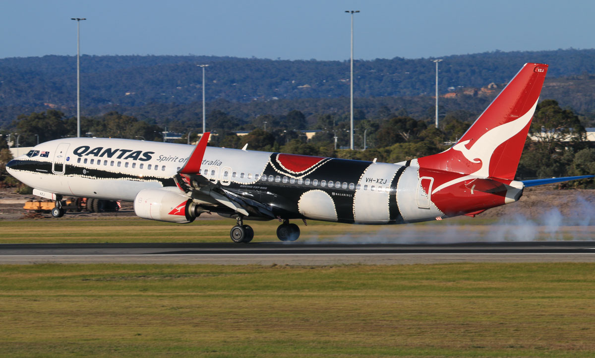"VH-XZJ Boeing 737-838 (MSN 39365/4669) of Qantas, in 'Mendoowoorrji' Aboriginal art livery, at Perth Airport – Fri 18 July 2014. Qantas painted this aircraft in a special Aboriginal art colour scheme, called ""Mendoowoorrji"", based on the work of the late Aboriginal artist Paddy Bedford. Landing on runway 03 as QF1073 from Broome at 15:58. Photo © David Eyre"