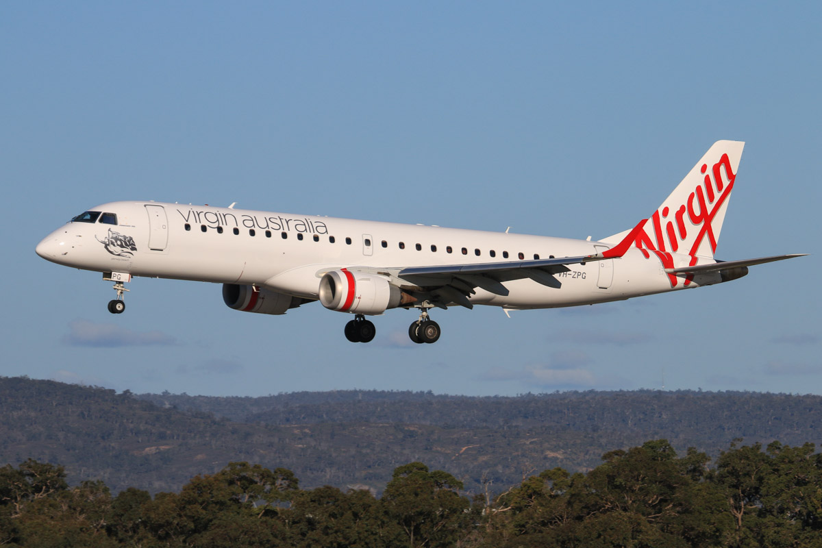 VH-ZPG Embraer 190AR (ERJ-190-100IGW) (MSN 19000195) of Virgin Australia, named 'Glenelg Beach', at Perth Airport – Fri 18 July 2014. Landing on runway 03 at 15:43 as flight VA717 from Adelaide. Photo © David Eyre