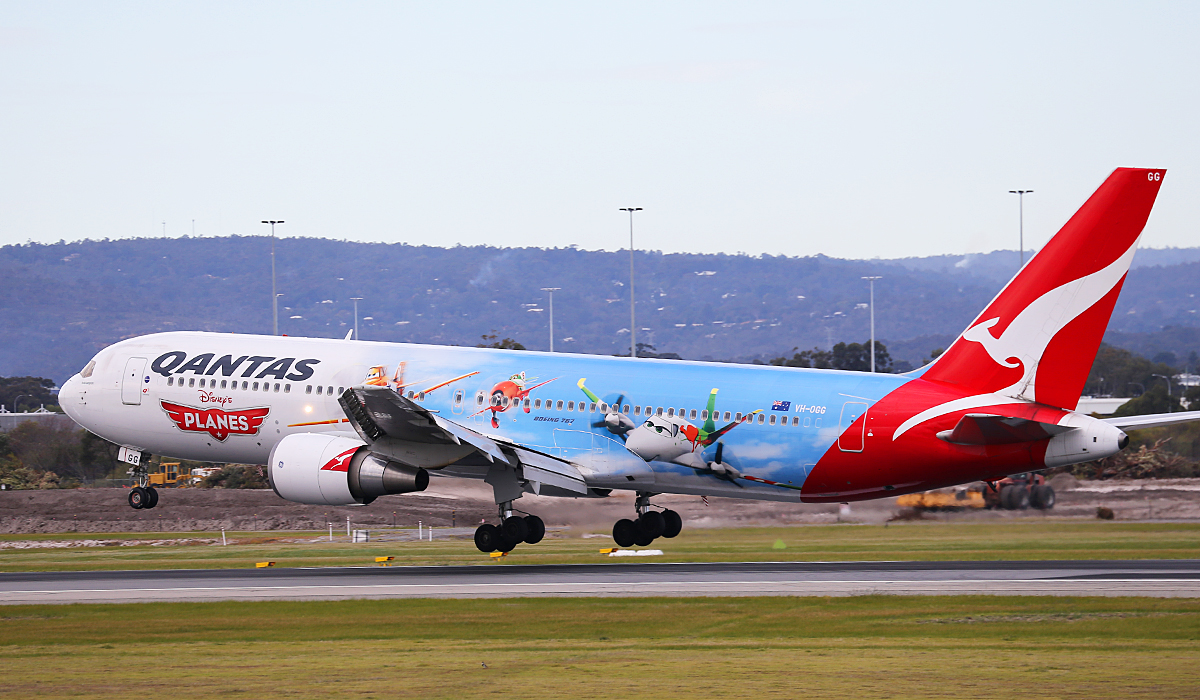 "VH-OGG Boeing 767-338 (MSN 24929/343) of Qantas, named ""Rockhampton"", in Disney's Planes special livery at Perth Airport – Sat 19 July 2014."