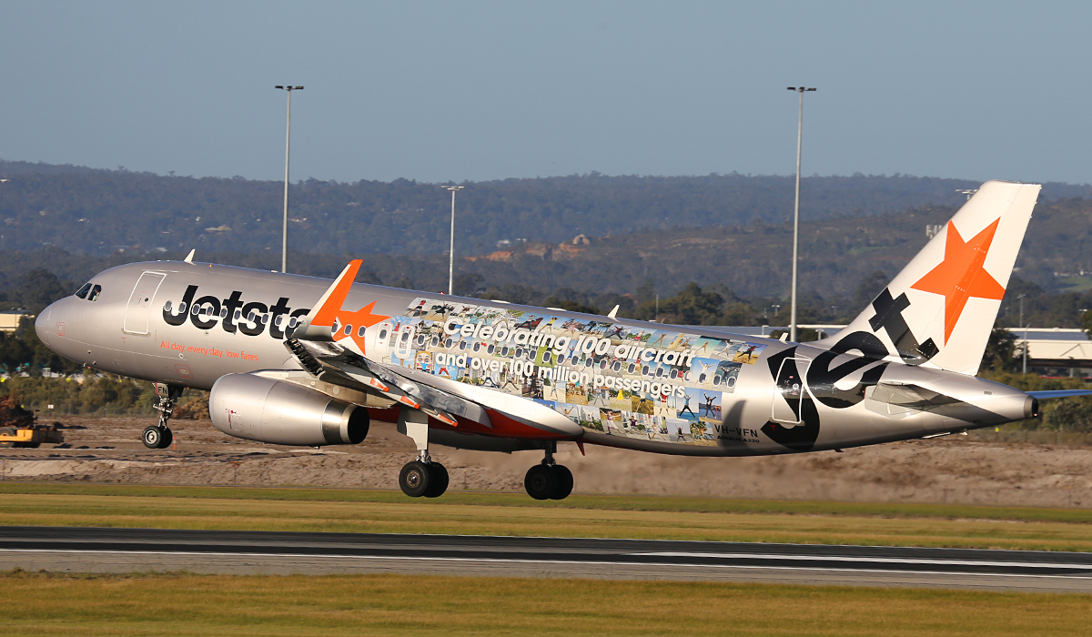 """VH-VFN Airbus A320-232 (MSN 5566) of Jetstar (leased from BOC Aviation Corp) – special """"Celebrating 100 aircraft and over 100 million passengers"""" livery at Perth Airport – Friday 1 August 2014."""