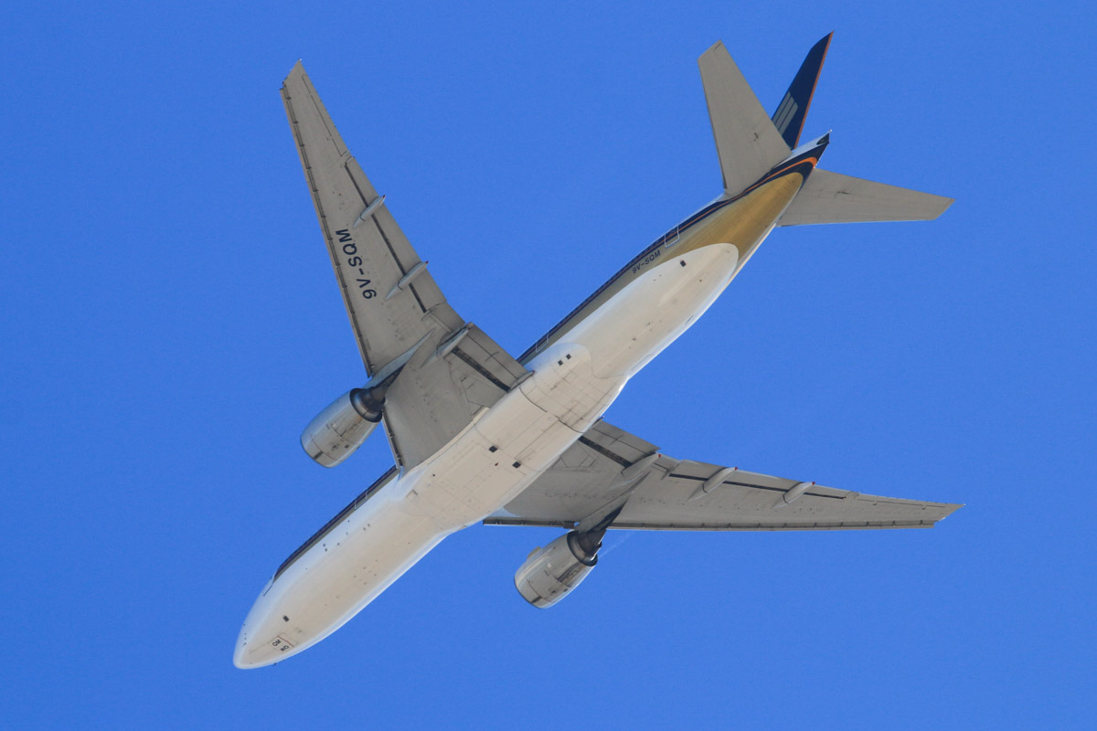 9V-SQM Boeing 777-212ER (MSN 33372/485) of Singapore Airlines, over Jandakot Airport - Sun 3 August 2014. Flight SQ213 from Singapore was on approach to Perth Airport's runway 03 and then broke off the approach and entered a single orbit over Jandakot (as seen here at 12:50pm), before continuing to Perth. Photo © David Eyre