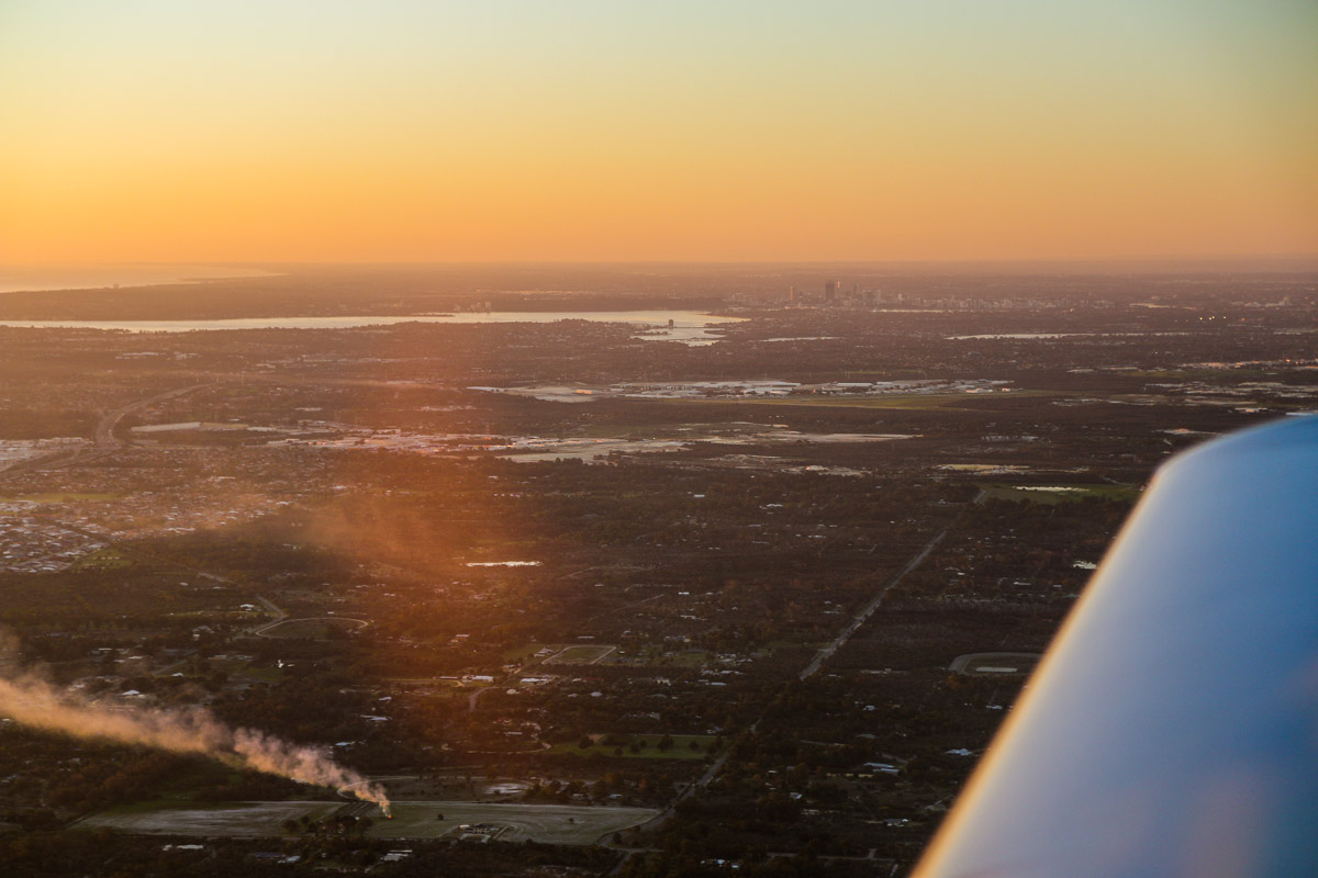 View north towards Jandakot Airport and Perth city from VH-ICE Cirrus SR22 GTS (Gen 5) (MSN 4063) owned by Andrew Dean – Sun 3 August 2014. This Cirrus is brand new (built in 2014). Photo © David Eyre